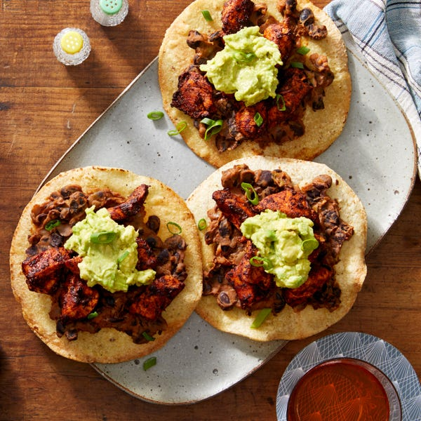 Mexico City Chicken Tinga Tostadas with Avocado & Refried Beans