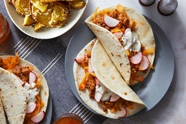 Pork Chorizo Tacos with Radishes, Roasted Potatoes, & Cotija Cheese