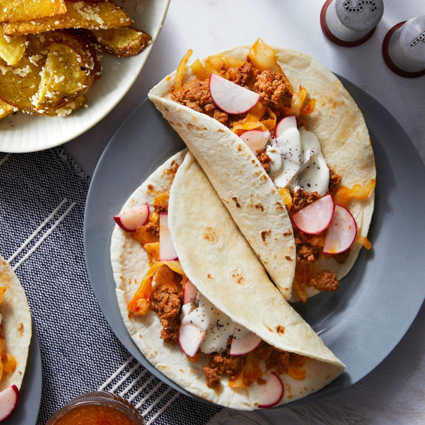 Pork Chorizo Tacos with Radishes, Roasted Potatoes, & Cotija Cheese
