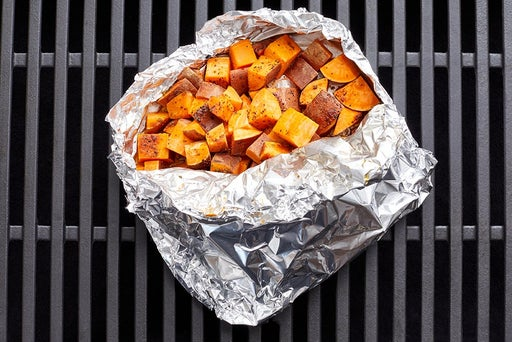 Assemble the foil packet & grill the sweet potatoes