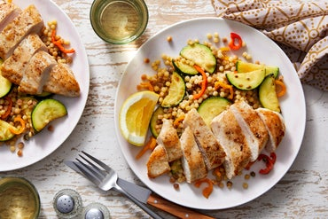 Seared Chicken over Pearl Couscous with Peppers, Zucchini, & Caper-Butter Sauce