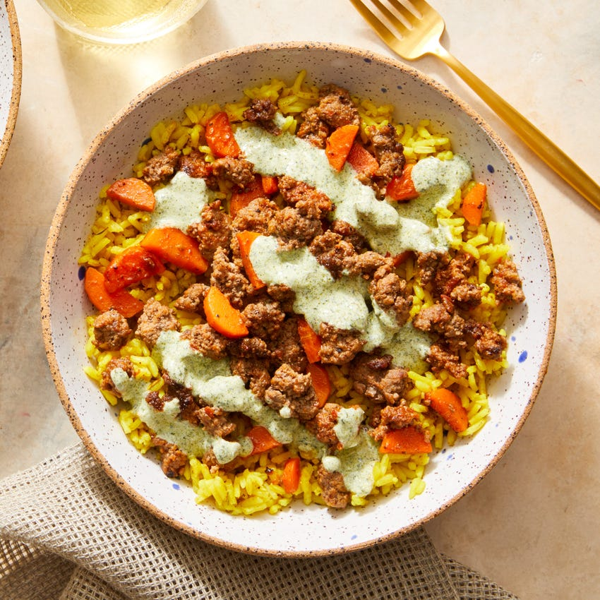 Beef over Curry-Spiced Rice with Creamy Cilantro Sauce