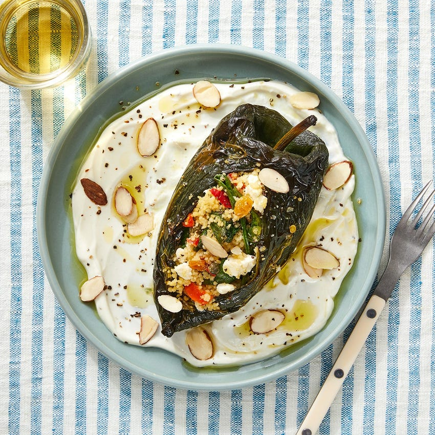 Couscous-Stuffed Poblano Peppers with Spinach, Raisins & Tahini Dressing