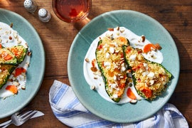 Couscous-Stuffed Peppers with Yogurt Sauce, Feta Cheese, & Tahini