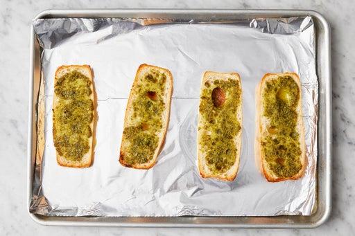 Make the pesto garlic bread: