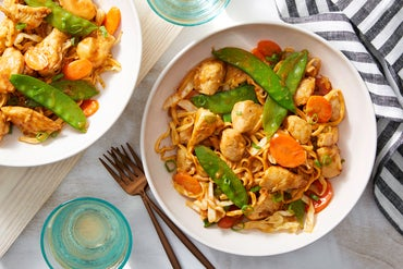 Chicken & Wonton Noodle Stir-Fry with Spring Peas, Carrots, & Cabbage