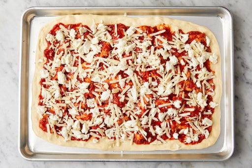 Assemble the pizza: