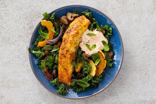 Finish & Serve the Vadouvan Salmon over Kale Salad