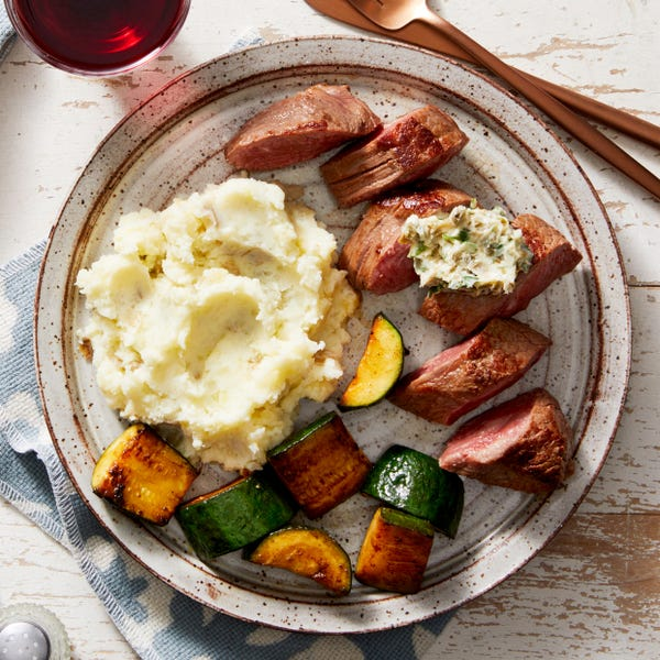 Seared Steaks & Parsley-Caper Butter with Creamy Mashed Potatoes & Zucchini