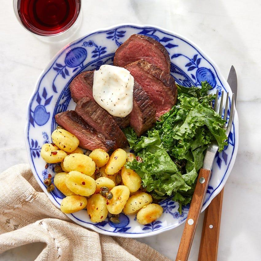 Pan-Seared Steaks & Aioli with Crispy Gnocchi & Sautéed Kale