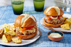 Pepper & Onion Pretzel Burgers with Roasted Potatoes & Aioli