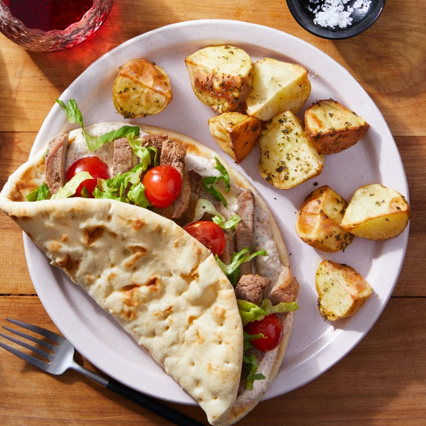 Sliced Beef Pitas with Za'atar Labneh Sauce & Roasted Potatoes