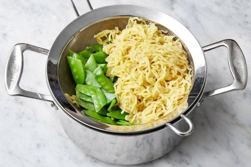 Cook the noodles & snow peas: