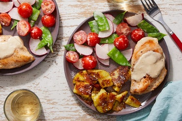 Tahini Chicken with Crispy Smashed Potatoes & Snow Pea-Tomato Salad
