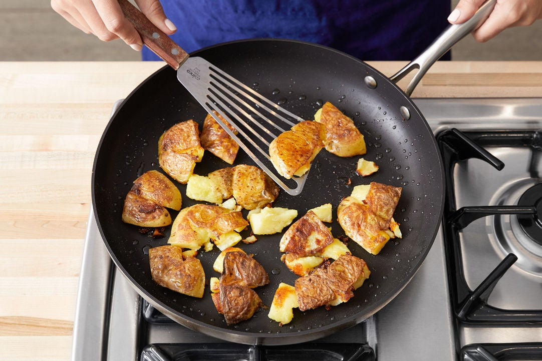Crisp the potatoes: