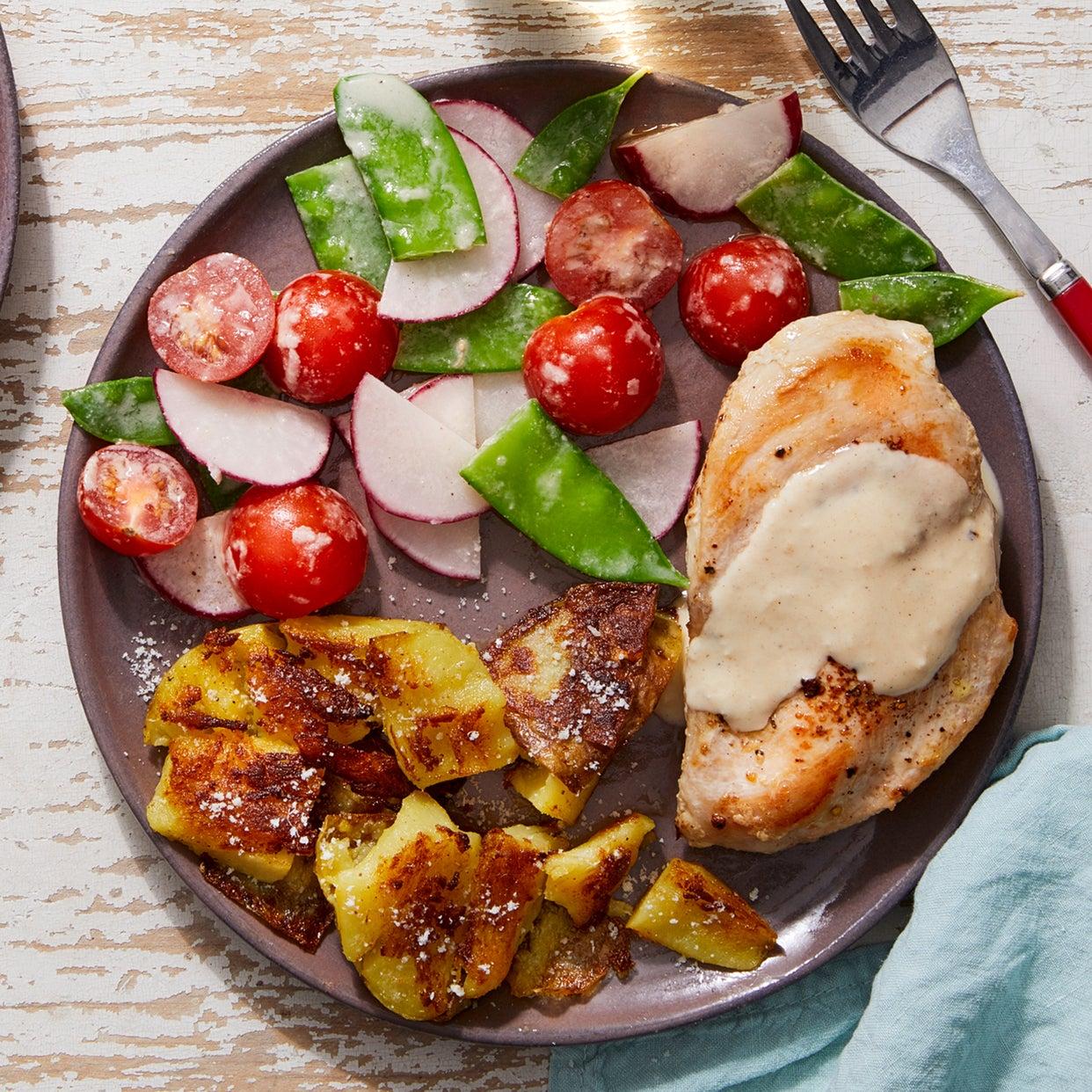 Tahini Chicken with Crispy Smashed Potatoes & Snow Pea-Tomato Salad
