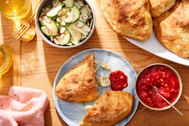 Cheesy Pesto Chicken Calzones with Tomato Sauce & Marinated Zucchini