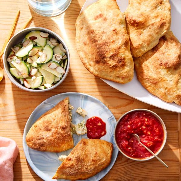 Cheesy Pesto Chicken Calzones with Tomato Sauce & Marinated Zucchini