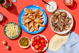 Chrissy Teigen's Chipotle-Lime Chicken Fajitas with Sauteed Mushrooms & Sweet Peppers