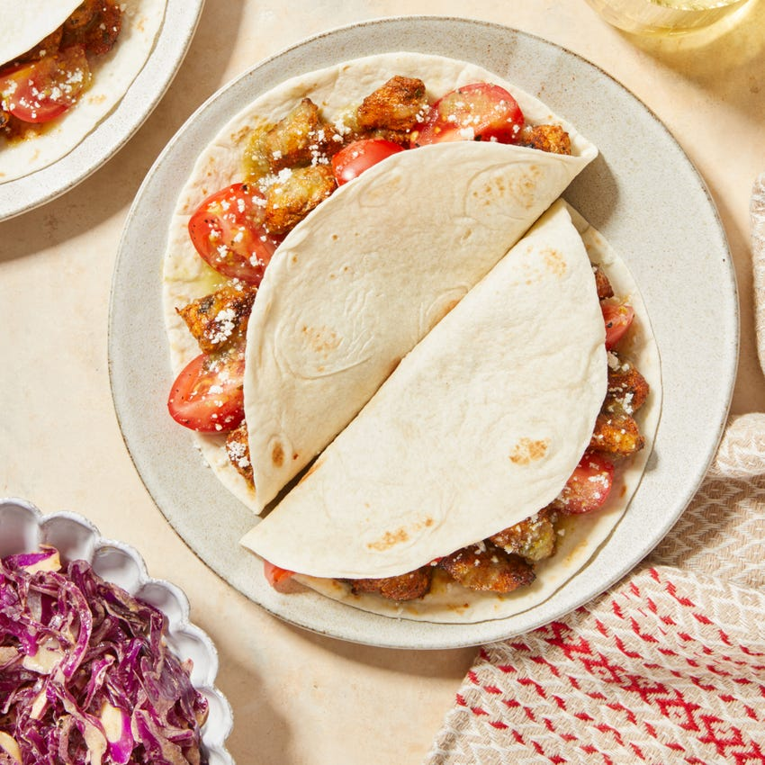 Tomatillo Chicken Tacos with Honey-Chipotle Slaw  & Cotija Cheese