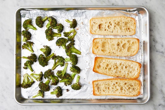 Toast the baguettes & finish the broccoli: