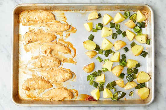 Bake the chicken & finish the peppers:
