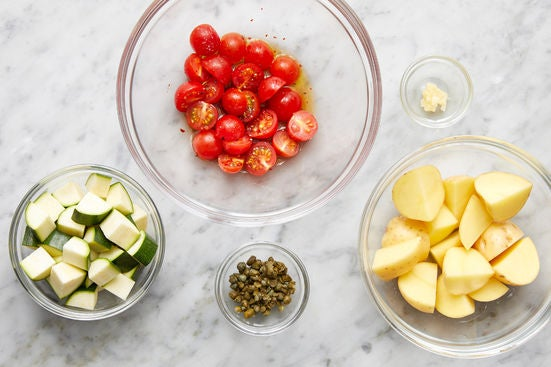 Prepare the ingredients & season the tomatoes: