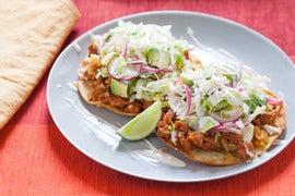 Chorizo Tostadas with Pickled Red Onions, Lime Crema & Queso Fresco