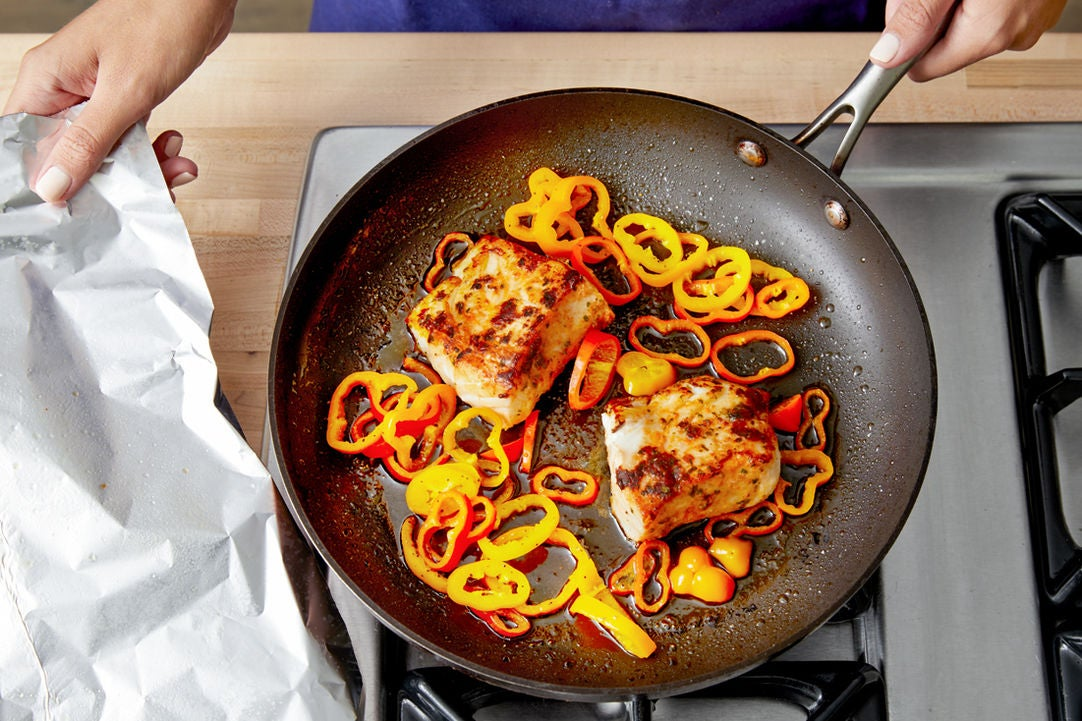 Cook the fish & peppers: