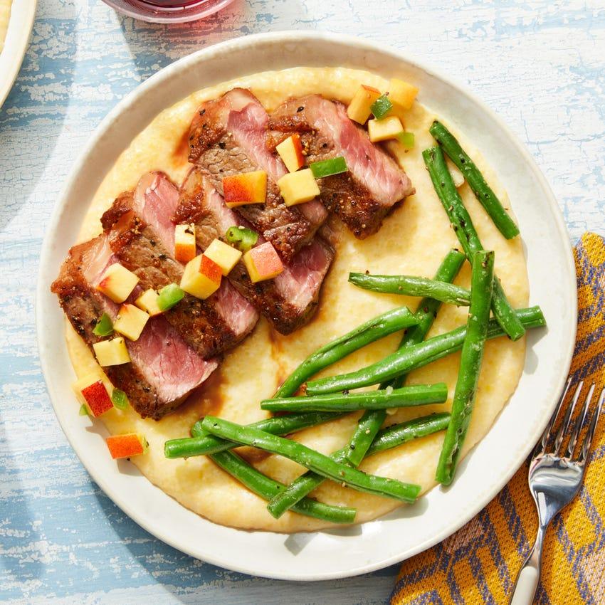 MasterChef Seared Steak over Goat Cheese Polenta with Jalapeño-Peach Salsa