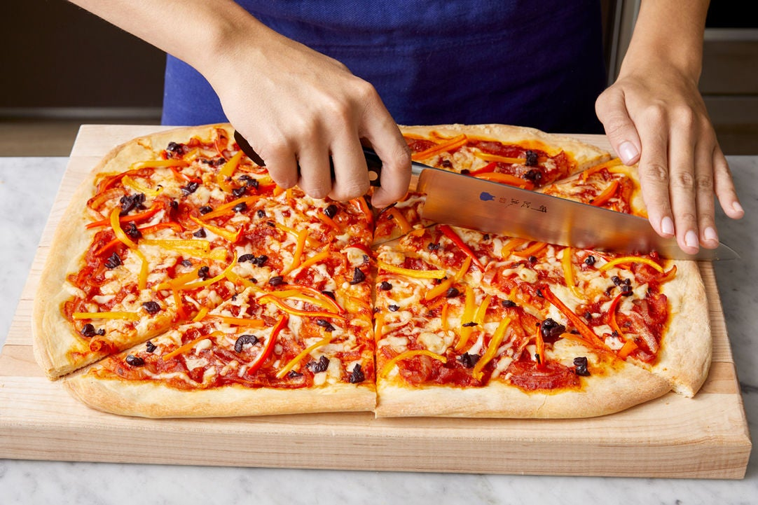 Slice the pizza & serve your dish: