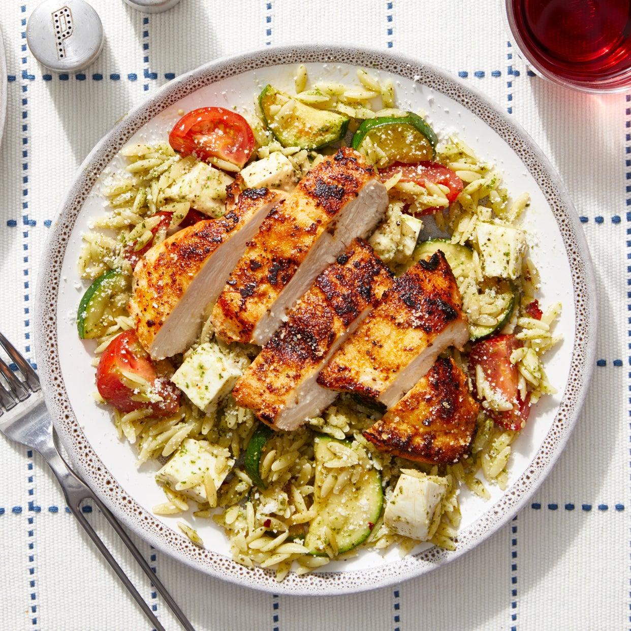 Seared Chicken over Orzo Pasta with Tomatoes,  Zucchini, & Basil Pesto