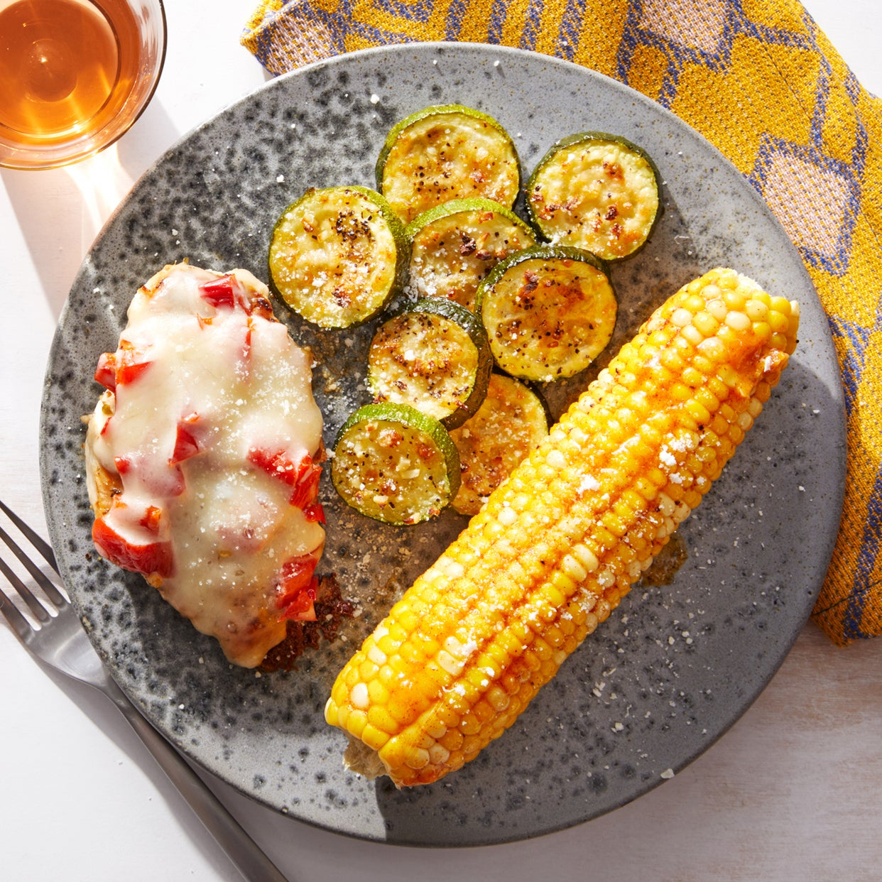 Asiago-Smothered Chicken with Roasted Zucchini & Smoky Corn