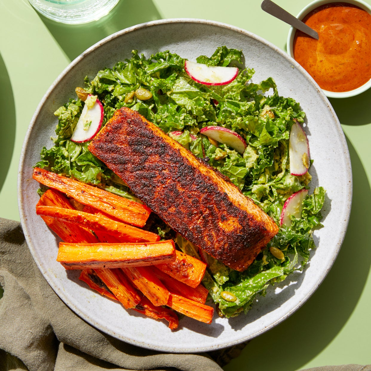 Spice-Crusted Salmon & Carrot Fries with Avocado-Kale Salad & Chipotle Dipping Sauce
