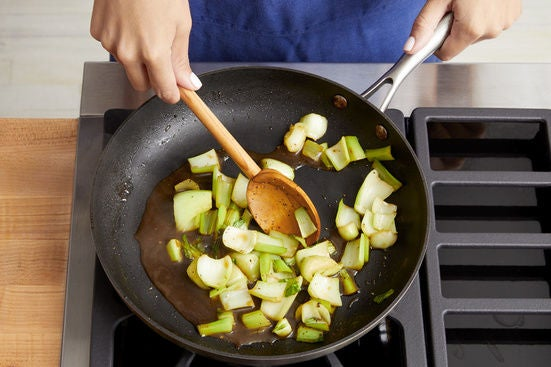 Cook the bok choy stems: