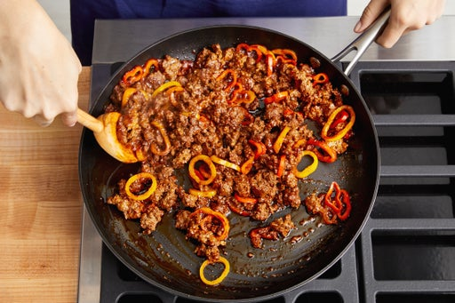 Cook the beef & sweet peppers: