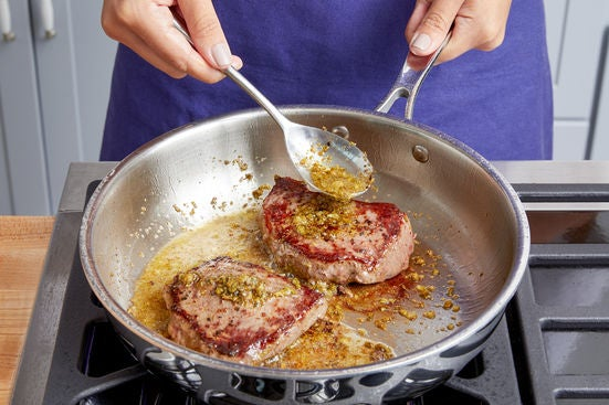 Make the pan sauce & finish the steaks: