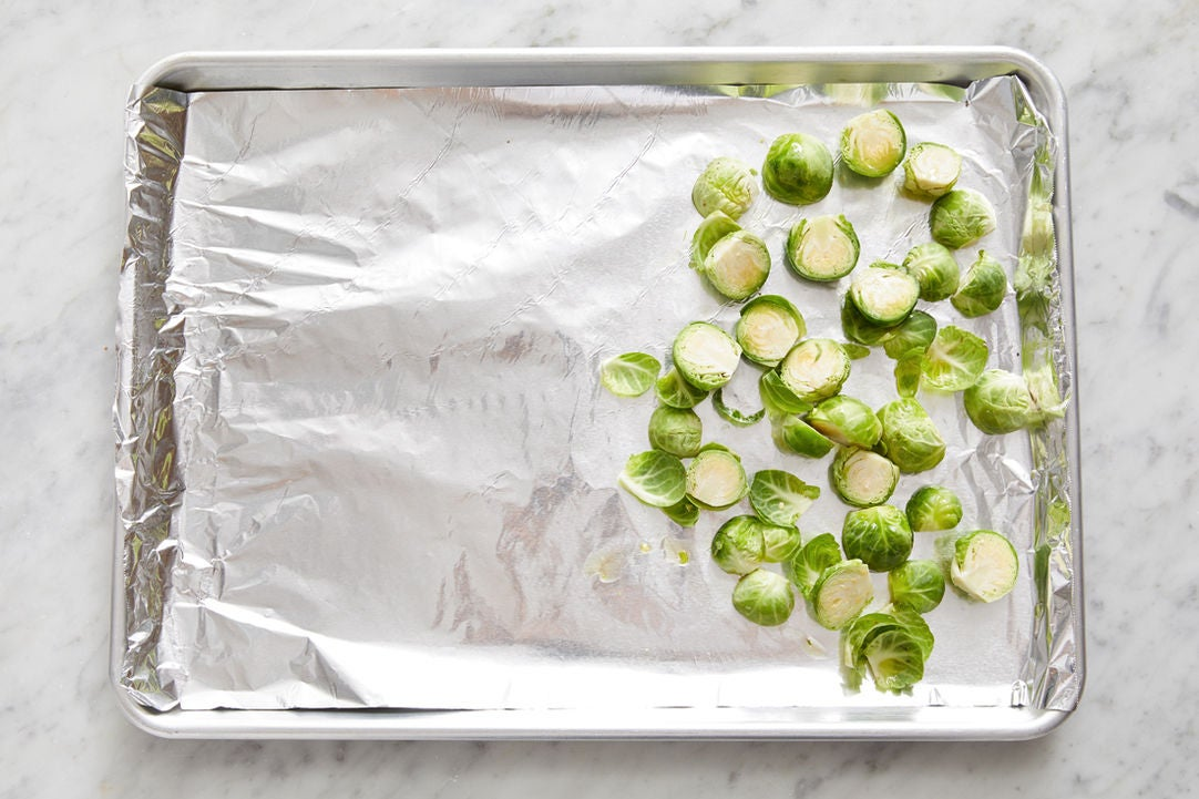 Prepare the Brussels sprouts: