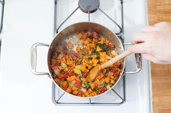 Add the spices & quinoa: