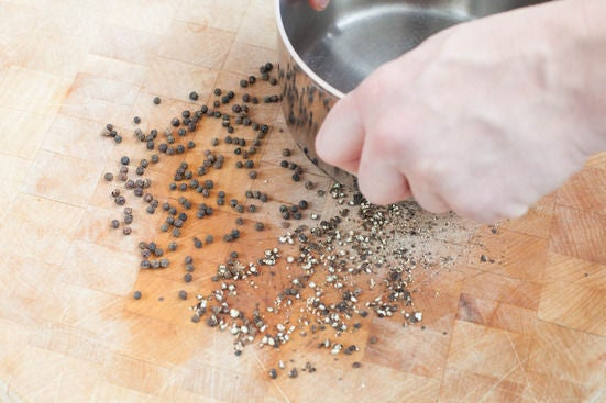 Crack the peppercorns: