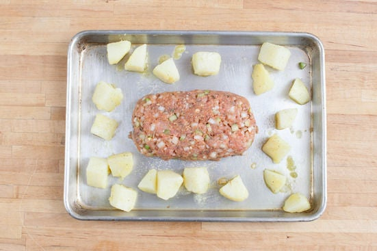 Roast the meatloaf & potatoes: