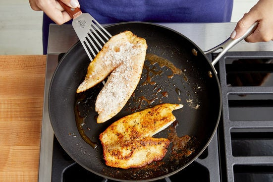 Coat & cook the fish: