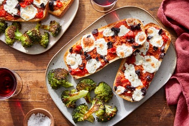 French Bread Pizzas with Olives, Peppers, & Fresh Mozzarella Cheese