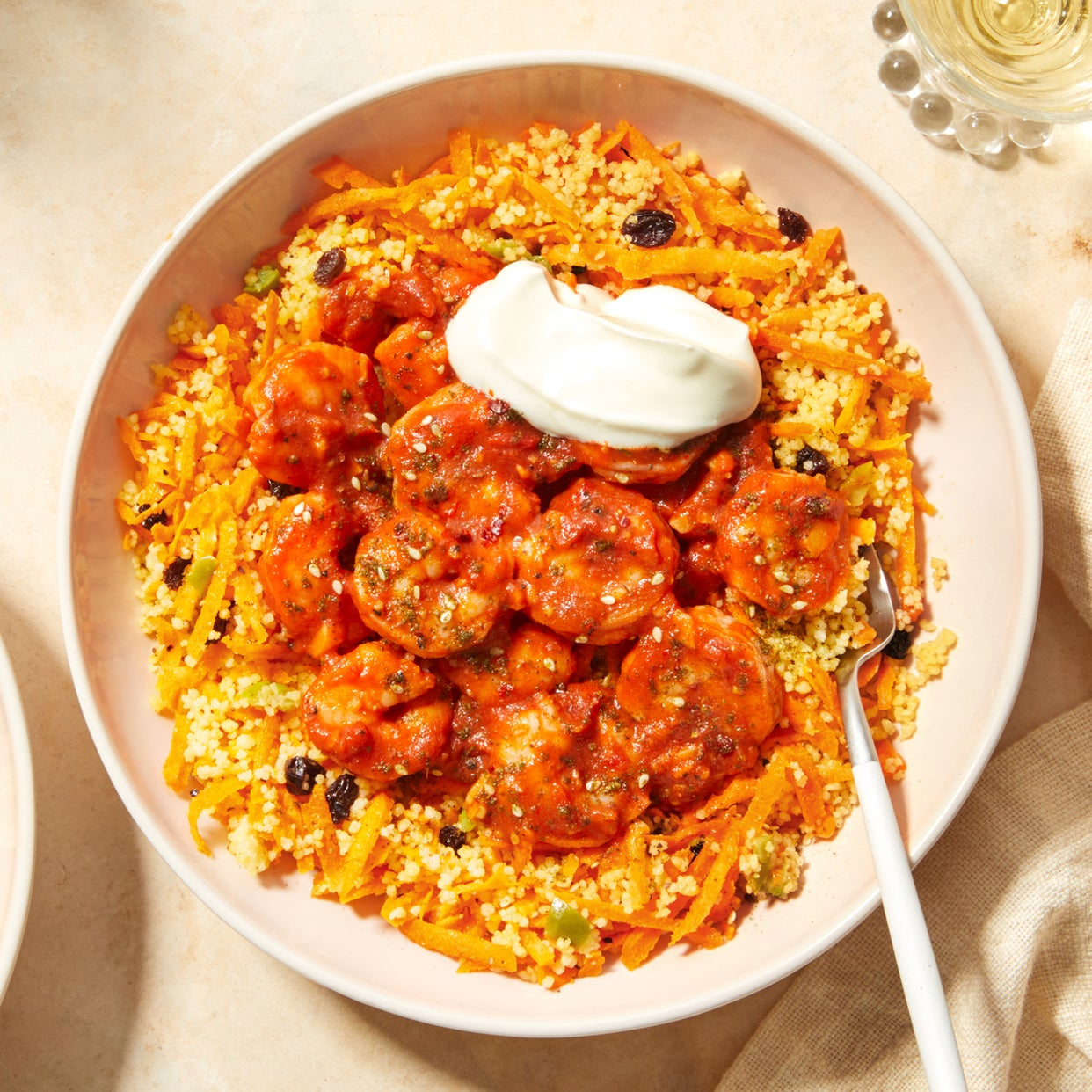Shrimp in Smoky Harissa Sauce with Couscous, Olives, & Currants