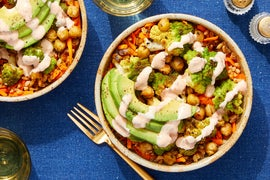 Spiced Cauliflower & Chickpea Bowl with Avocado, Dates, & Harissa Yogurt