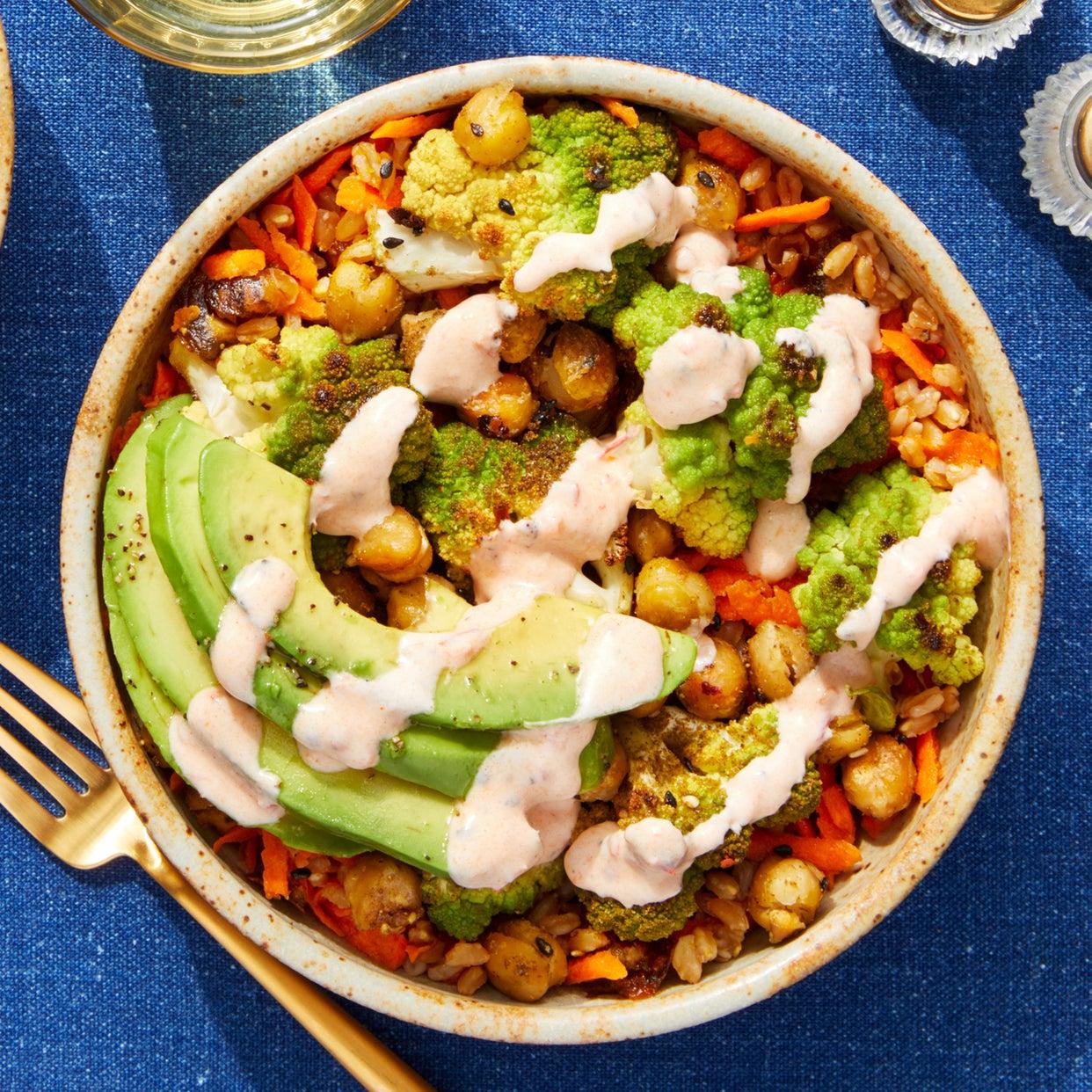 Spiced Cauliflower & Chickpea Bowl with Avocado, Dates, & Harissa Yogurt