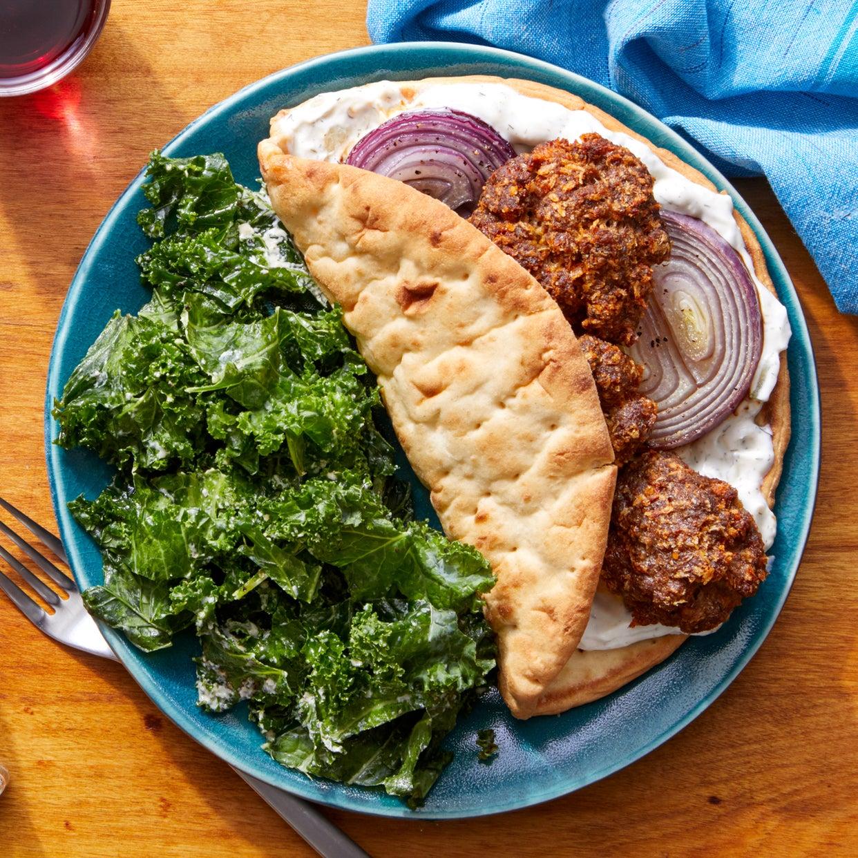 Oven-Baked Meatball Pitas with Tzatziki & Marinated Kale