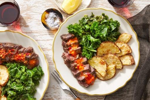 Seared Steaks & Garlic Kale with Cheesy Roasted Potatoes