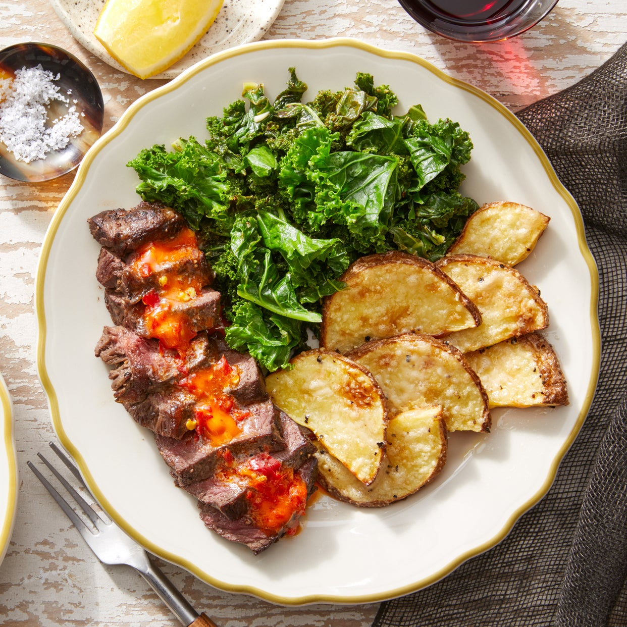 Seared Steaks & Garlic Kale with Cheesy Roasted Potatoes