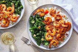 Cajun-Spiced Shrimp over Creamy Rice with Sautéed Kale